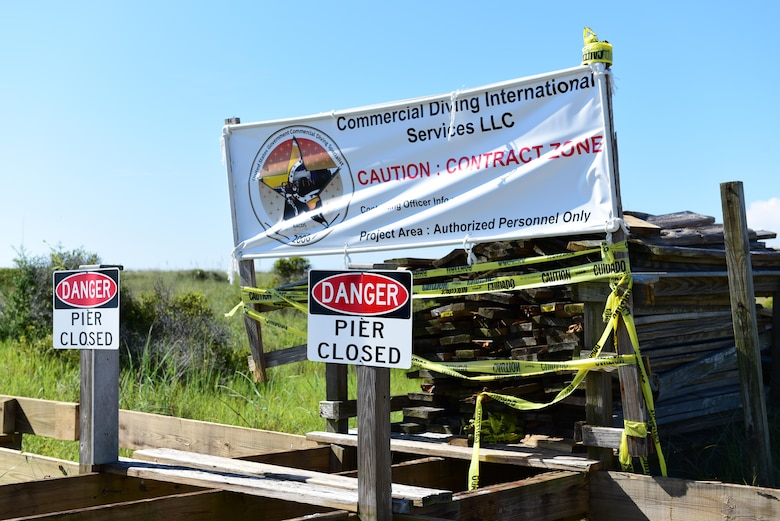 A sign set up by Commercial Diving International Services sits on a deconstructed boardwalk at Shell Island, Fla., Aug. 10, 2017. The construction on the pier and boardwalk on the Tyndall side of Shell Island began July 31, 2017, and is scheduled to be completed before Labor Day 2017.