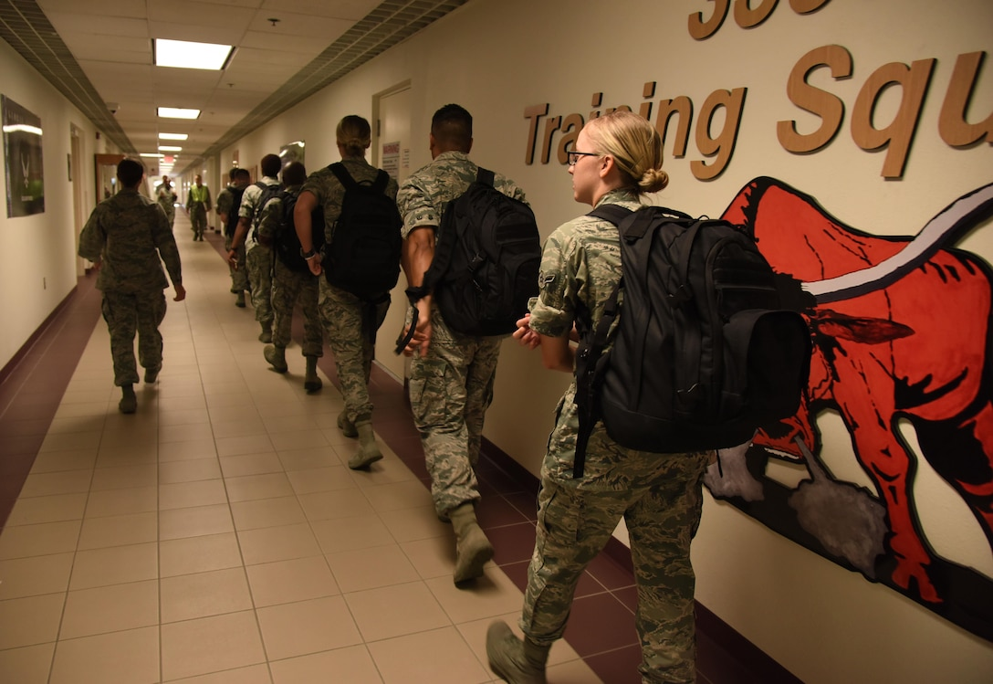 Airmen from the 335th Training Squadron in-process into Wolfe Hall for sheltering during a hurricane exercise Aug. 11, 2017, on Keesler Air Force Base, Miss. Each year Keesler personnel participate in exercise scenarios like this to ensure they can respond to hurricane threats. (U.S. Air Force photo by Kemberly Groue)