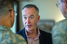 U.S. Air Force Col. John Klein, 60th Air Mobility Wing commander, talks with Marine Corps Gen. Joseph F. Dunford Jr., Chairman of the Joint Chiefs of Staff, during a gas and go at Travis Air Force Base, Calif., Aug, 10, 2017. (U.S. Air Force photo by Louis Briscese)