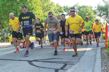 Col. Chris Black, running bib 2274, commander, 1st Combat Aviation Brigade, 1st Infantry Division, joins warrant officers in a 5K run celebrating the 99th anniversary of the U.S. Army Warrant Officer Corps at Riley's Conference Center July 10 at Fort Riley.