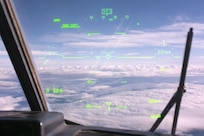 Clouds blanket the Alaska interior through the heads-up display in a British Royal Air Force C-130 Hercules, Aug. 11, 2017. The RAF airmen are at JBER for training exercise Red Flag-Alaska 17-3.