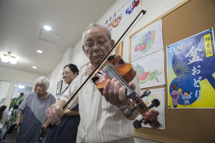 Americans dance with Japanese locals to honor ancestors