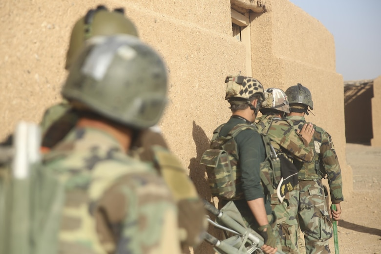 Afghan National Army soldiers with 215th Corps prepare to clear a simulated enemy compound during casualty evacuation training at Camp Shorabak, Afghanistan, Aug. 14, 2017. More than 30 ANA soldiers partnered with the Afghan Air Force and U.S. advisors, extracting notionally-wounded personnel via helicopter in preparation for future operations. Faster CASEVACS allow for quick and safe transportation of injured soldiers to medical facilities, greatly improving their chances of survival and recovery. (U.S. Marine Corps photo by Sgt. Lucas Hopkins)