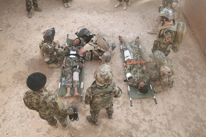 Afghan National Army soldiers with 215th Corps prepare to carry notionally-wounded personnel onto an Afghan Air Force Mi-17 Helicopter during casualty evacuation training at Camp Shorabak, Afghanistan, Aug. 14, 2017. Several ANA units rehearsed and refined their CASEVAC process and quickened response times, helping to improve chances of survivability and recovery for injured service members. (U.S. Marine Corps photo by Sgt. Lucas Hopkins)
