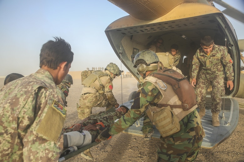 Afghan National Army soldiers with 215th Corps load a simulated casualty onto an Afghan Air Force Mi-17 Helicopter during casualty evacuation training at Camp Shorabak, Afghanistan, Aug. 14, 2017. More than 30 ANA soldiers with various units worked to refine their CASEVAC procedures in preparation for real-world operations. Quickening response time and providing proper medical care before extraction vastly increases the chances of survivability and recovery for wounded personnel. (U.S. Marine Corps photo by Sgt. Lucas Hopkins)