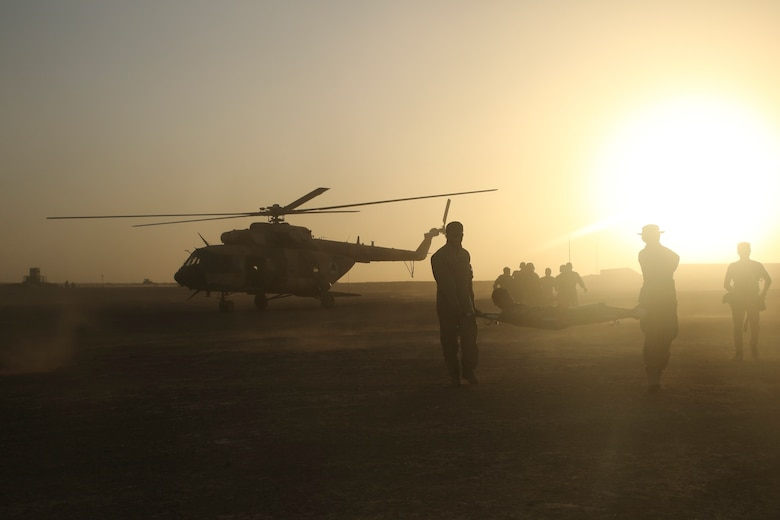 Afghan National Army soldiers extract a notional casualty from an Afghan Air Force Mi-17 Helicopter during casualty evacuation training at Camp Shorabak, Afghanistan, Aug. 14, 2017. Several ANA units partnered with the Afghan Air Force and U.S. advisors to enhance their CASEVAC procedures through classroom instruction and practical application. Quickening the CASEVAC process allows for faster movement of a wounded soldier to a medical facility and greatly improves chances for survivability and full recovery. (U.S. Marine Corps photo by Sgt. Lucas Hopkins)