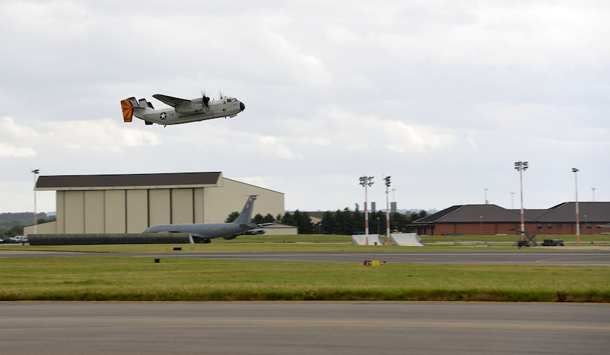 A U.S. Navy C-2A Greyhound takes off from the airfield on RAF Mildenhall, England, as it heads out as part of Exercise Saxon Warrior Aug. 3, 2017. Two C-2A aircraft were TDY to RAF Mildenhall as part of Exercise Saxon Warrior, a multinational joint maritime exercise involving 15 warships from five different nations, along with submarines, more than 100 aircraft and approximately 9,000 personnel. (U.S. Air Force photo by Karen Abeyasekere)