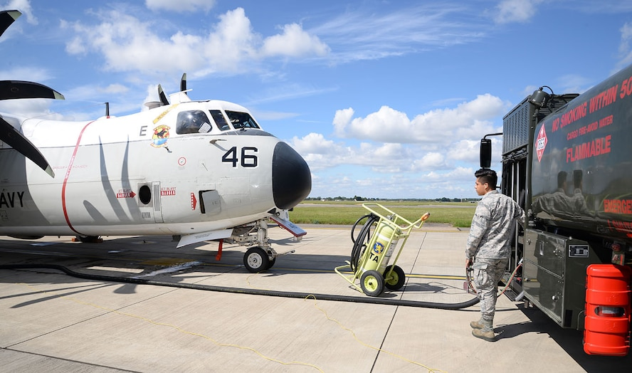 U.S. Air Force Airman Andrew Garibaldo, 100th Logistics Readiness Squadron, pumps fuel onto a U.S. Navy C-2A Greyhound Aug. 2, 2017, on RAF Mildenhall, England. Members of the U.S. Navy, VRC-40, from Norfolk, Va., were here as part of Exercise Saxon Warrior. The Greyhounds cannot be refueled in the air so they were refueled by truck while on the ground. (U.S. Air Force photo by Karen Abeyasekere)