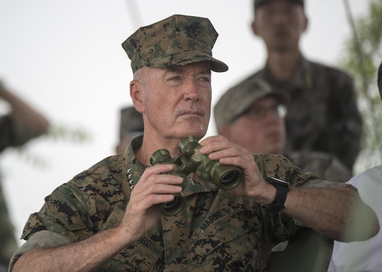 Marine Corps Gen. Joe Dunford, chairman of the Joint Chiefs of Staff, observes an attack exercise by Chinese troops