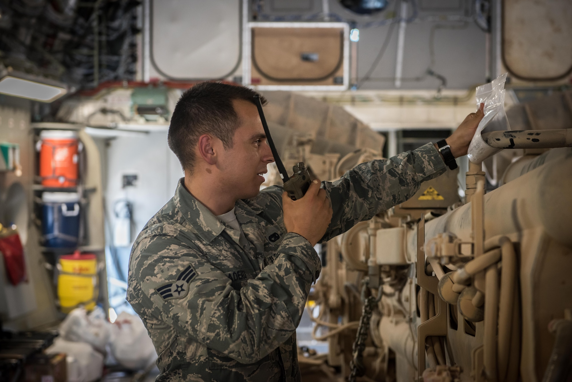 Senior Airman David Tiradeau, a ramp coordinator assigned to the 386th Expeditionary Logistics Readiness Squadron, relays information to the air terminal operations center, at an undisclosed location in Southwest Asia, August 15, 2017.