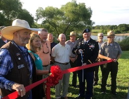 Lt. Col. Brent Legreid, deputy commander, Kansas City District, U.S. Army Corps of Engineers, joined local, state and federal officials to cut the ribbon rededicating the Milford Lake Dam on its 50th anniversary August 12, 2017.
