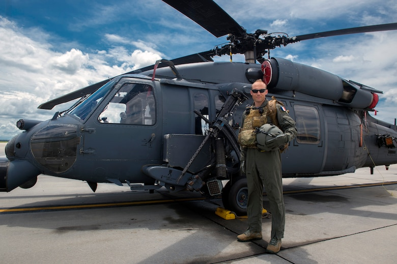 Commandant Micka, a French exchange pilot and assistant director of operations for Moody's 41st Rescue Squadron, stands in front of an HH-60G Pavehawk, Aug. 2, 2017, at Moody Air Force Base, Ga. Prior to his arrival at the 41st RQS, Micka transitioned from flying the French Air Force's EC-725 Caracal helicopter to learn the HH-60. Since childhood, Micka aspired to serve and fly for the French and U.S. military as a rescue pilot. (U.S. Air Force photo by Senior Airman Greg Nash)