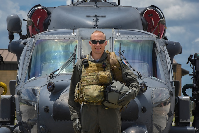 Commandant Micka, a French exchange pilot and assistant director of operations for Moody's 41st Rescue Squadron, stands in front of an HH-60G Pavehawk, Aug. 2, 2017, at Moody Air Force Base, Ga. Prior to his arrival at the 41st RQS, Micka transitioned from flying the French Air Force's EC-725 Caracal helicopter to learn the HH-60. Since his childhood, Micka aspired to serve and fly for the French and U.S. military as a rescue pilot. (U.S. Air Force photo by Senior Airman Greg Nash)