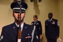 Senior Airman Anthony Balancio, Keesler Honor Guard member, presents the colors during a retirement ceremony for Chief Master Sgt. Vegas Clark, 81st Training Wing command chief, in the Bay Breeze Event Center Aug. 11, 2017, on Keesler Air Force Base, Miss. Clark retired with 22 years of military service. Prior to his assignment at Keesler he served as the command chief for the 39th Air Base Wing, Incirlik Air Base, Turkey. (U.S. Air Force photo by Kemberly Groue)