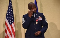 Chief Master Sgt. Vegas Clark, 81st Training Wing command chief, wipes his eye during his retirement ceremony in the Bay Breeze Event Center Aug. 11, 2017, on Keesler Air Force Base, Miss. Clark retired with 22 years of military service. Prior to his assignment at Keesler he served as the command chief for the 39th Air Base Wing, Incirlik Air Base, Turkey. (U.S. Air Force photo by Kemberly Groue)