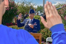914th Air Refueling Wing Commander, Col. Brian S. Bowman, administers the Oath of Enlistment to Air Force Reserve recruits at the 2017 Erie County Fair.