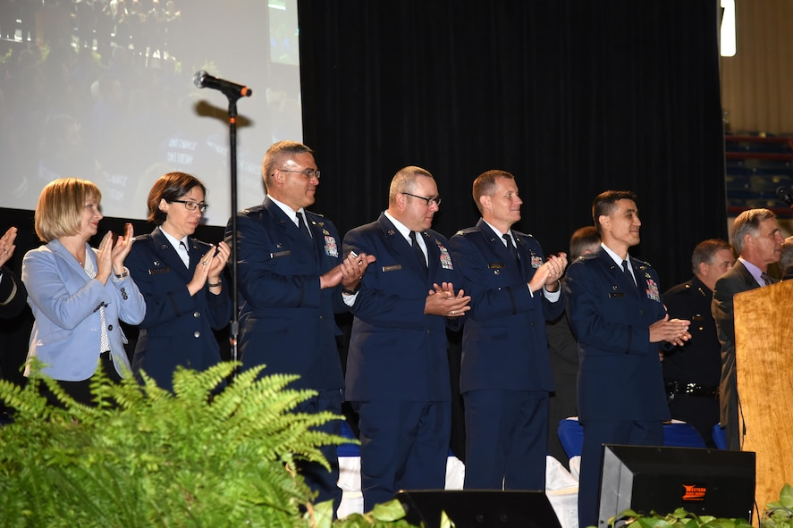 Toni Hansen, 17th Mission Support Group deputy director, U.S. Air Force Col. Janet Urbanski, 17th Medical Group commander, Col. Alex Ganster, 17th Training Group commander, Chief Master Sgt. Daniel Stein, 17th Training Group superintendent, Col. Jeffrey Sorrell, 17th Training Wing vice commander and Col. Ricky Mills, 17th Training Wing commander are welcomed as guests of honor to the San Angelo Independent School District annual convocation signifying the kickoff of the 2017-2018 school year at the Foster Communications Colosseum, San Angelo, Texas, Aug. 15, 2017.
