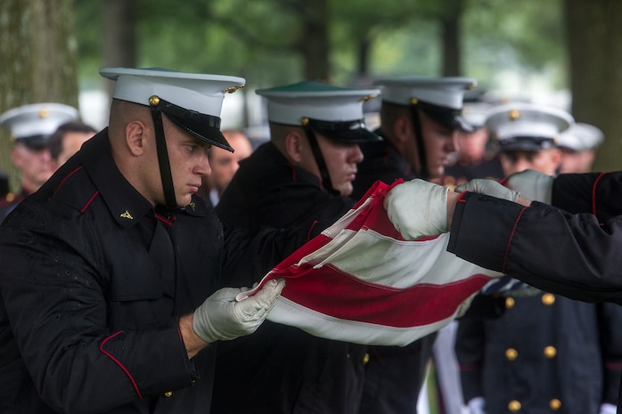 Marine Corps Body Bearers with Bravo Company, Marine Barracks Washington D.C., fold the National Ensign during a funeral for Marine Sgt. Joseph J. Murray at Arlington National Cemetery, Arlington, Va., Aug. 15, 2017. Murray, 26, was one of the 15 Marines and one Navy sailor who perished when their KC130-T Hercules crashed in Mississippi, July 10, 2017. Murray was a Critical Skills Operator with the 2nd Raider Battalion, Marine Corps Forces Special Operations Command (MARSOC). (Official U.S. Marine Corps photo by Cpl. Robert Knapp/Released)
