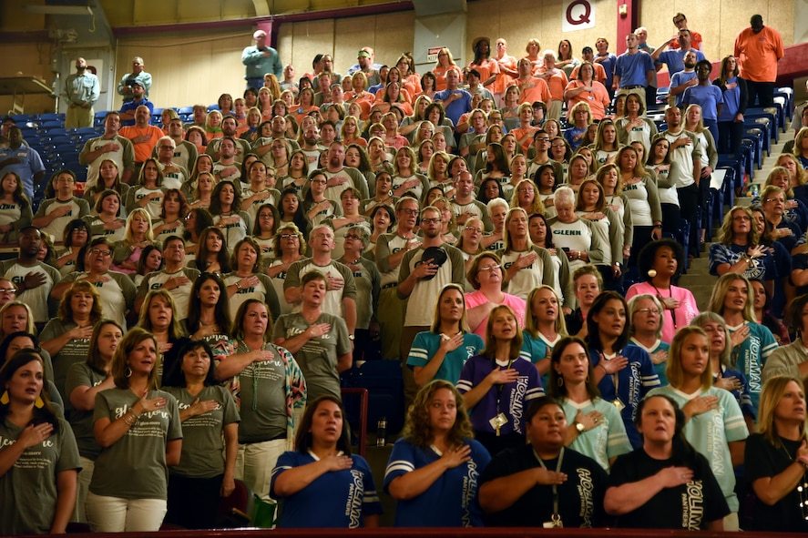 Faculty and staff from the San Angelo Independent School District recite the Pledge of Allegiance at the annual convocation signifying the kickoff of the 2017-2018 school year at the Foster Communications Colosseum, San Angelo, Texas, Aug. 15, 2017.