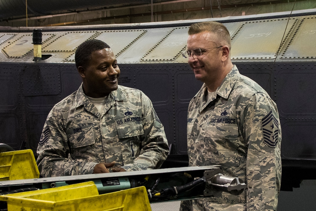 U.S. Air Force Tech. Sgt. Darron Daye, left, 4th Equipment Maintenance Squadron armament maintenance floor supervisor, describes maintenance operations to Chief Master Sgt. David Wade, 9th Air Force command chief, Aug. 14, 2017, at Seymour Johnson Air Force Base, N.C. Wade visited various 4th Maintenance Group flights and spoke with Airmen about their mission to support dominant Strike Eagle airpower. (U.S. Air Force photo by Airman 1st Class Shawna L. Keyes)