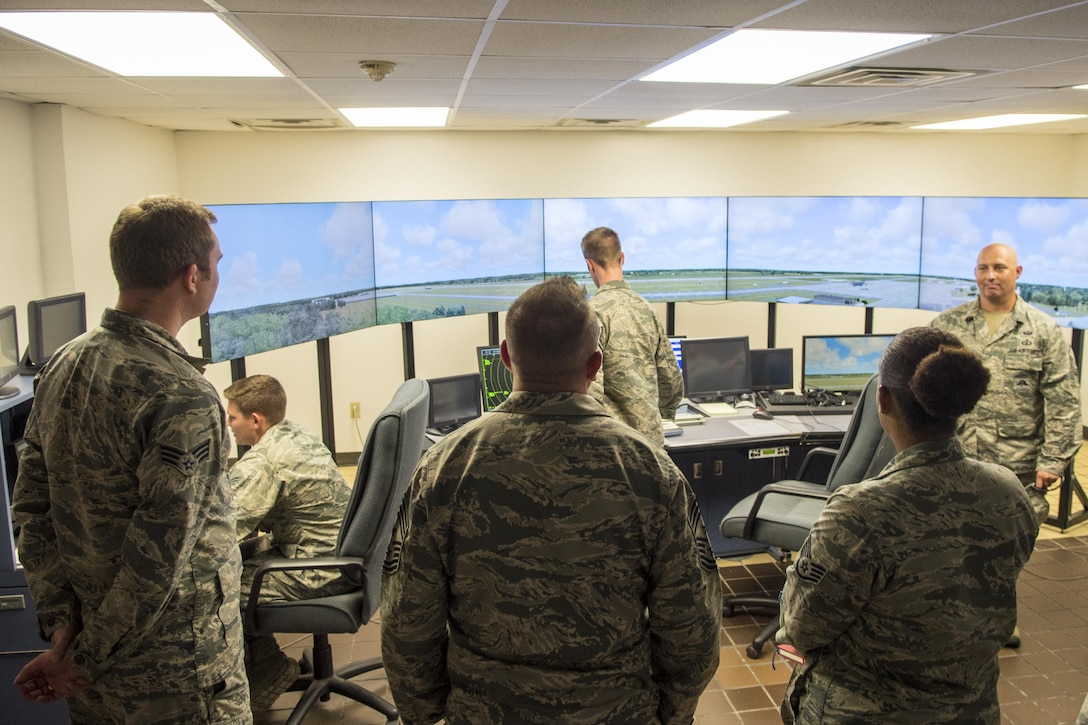 U.S. Air Force Chief Master Sgt. David Wade, center, 9th Air Force command chief, visits the air traffic control training simulator, Aug. 14, 2017, at Seymour Johnson Air Force Base, N.C. Airmen from the 4th Operational Support Squadron air traffic control use the simulator to continue training after technical school and maintain proficiency while supporting the Team Seymour mission in the air traffic control tower. (U.S. Air Force photo by Airman 1st Class Shawna L. Keyes)
