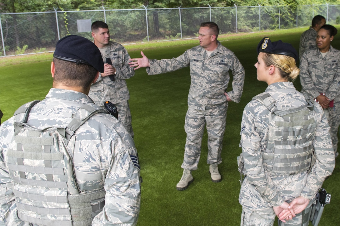 U.S. Air Force Chief Master Sgt. David Wade, left, 9th Air Force command chief, visits the 4th Medical Support Squadron laboratory and speaks with Staff Sgt. Erin Holmquist, 4th MDSS NCO in-charge of hematology, Aug. 14, 2017, at Seymour Johnson Air Force Base, N.C. Wade visited various 4th Medical Group flights and spoke with Airmen about their mission to provide health care to those supporting Strike Eagle airpower. (U.S. Air Force photo by Airman 1st Class Shawna L. Keyes)