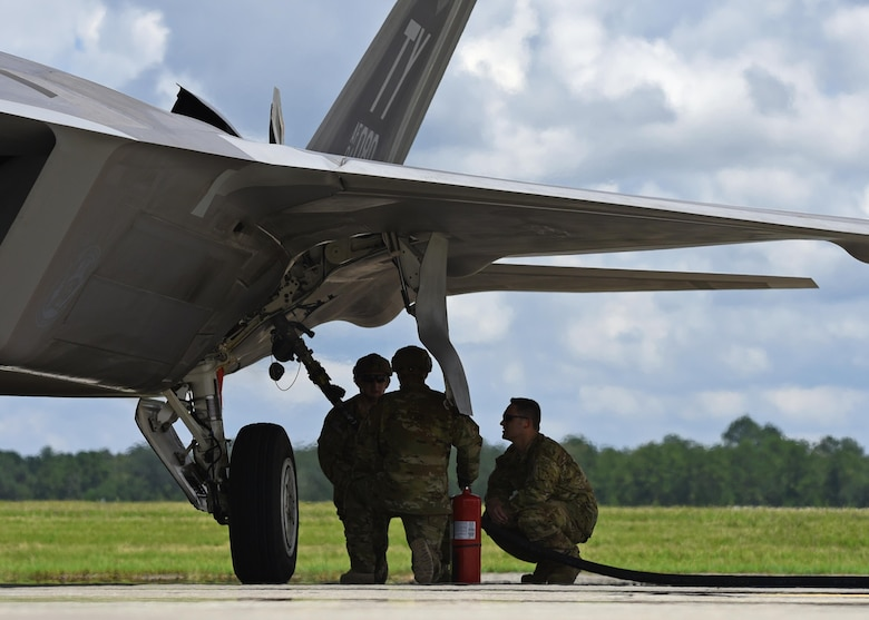 An F-22 Raptor from the 95th Fighter Squadron, Tyndall Air Force Base, Fla., receives fuel from a forward area refueling point from an HC-130J Combat King II during exercise Stealth Guardian at Moody Air Force Base, Ga., Aug. 10, 2017. The FARP program allows an HC-130J Combat King II to be used as a fuel provider when conventional fueling stations or air-to-air refueling options are not possible.