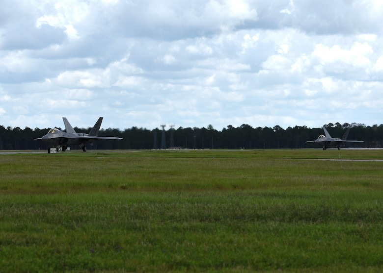 A pair of 95th Fighter Squadron F-22 Raptors from Tyndall Air Force Base, Fla., taxi down the flightline at Moody Air Force Base, Ga., during a forward area refueling point operation in conjunction with exercise Stealth Guardian Aug. 10, 2017. The inaugural exercise Stealth Guardian is designed to demonstrate the Air Force's ability to quickly deploy F-22 assets at a moment's notice while showcasing the ability to establish flying operations in combat or contingency environments.