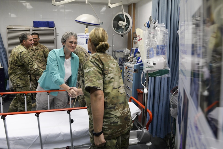 Secretary of the Air Force Heather Wilson shakes hands with U.S. Air Force Tech. Sgt. Ashley Hall, dental assistant assigned to the 379th Expeditionary Medical Group, at Al Udeid Air Base, Qatar, Aug. 15, 2017. During the visit Wilson and Air Force Chief of Staff Gen. David L. Goldfein spent time with Airmen, learning about their contributions to U.S. Air Forces Central Command. (U.S. Air Force photo by Tech. Sgt. Bradly A. Schneider)