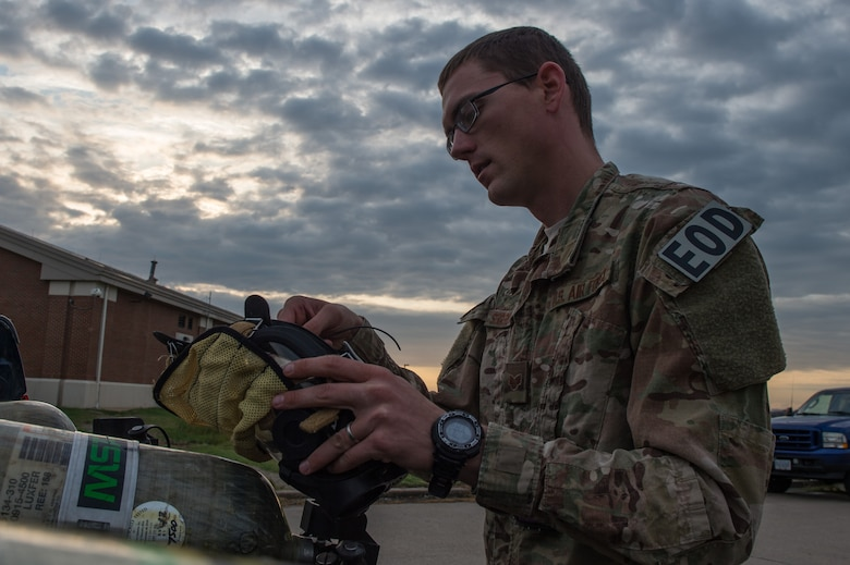 U.S. Air Force Staff Sgt.Steven Segerlund, 23rd Civil Engineer Squadron explosive ordinance disposal technician, adjusts his mask during Operation Llama Fury 3.0 at Joint Base Langley-Eustis, Va., Aug. 9, 2016.