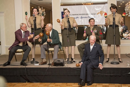 Harold S. Sheffield and Henry Kudzik, World War II Raiders, sit on the stage and participate in the entertainment portion of the evening with The Lindy Sisters during the 2017 Marine Raider Association Reunion in San Diego, Aug. 11.