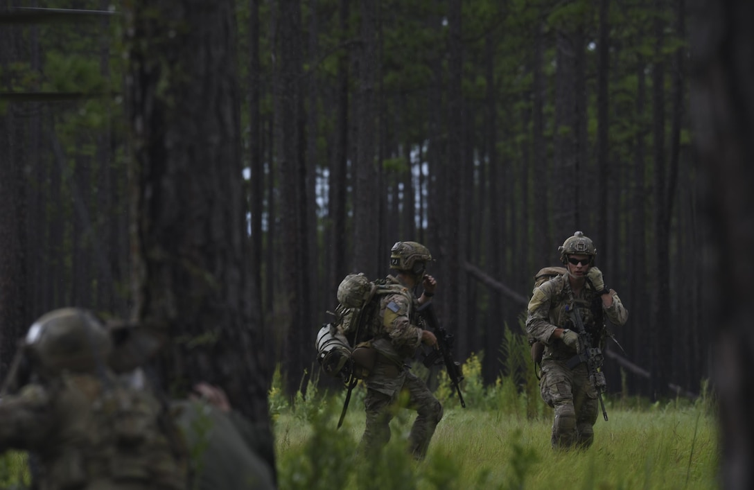 U.S. Air Force pararescuemen from Moody Air Force Base, Ga., disembark from an HH-60G Pave Hawk and begin sweeping a wooded area near Tyndall Air Force Base, Fla., for simulated hostiles during a pilot recovery mission while taking part in Stealth Guardian Aug. 8, 2017.