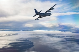 A U.S. Marine Corps KC-130J with Marine Aerial Refueler Transport Squadron (VMGR) 152, conducts formation flights while in transit to Naval Air Station Whidbey Island, Washington, Aug. 13, 2017. VMGR-152 is participating in unit-level training Evergreen. The training consists of division formation flights with stateside-based VMGR squadrons and tri-lateral training with the U.S. Army 160th Special Operations Aviation Regiment and U.S. Army 1st Special Forces Group to gain valuable insight on the most recent Operation Inherent Resolve assault support tactics.