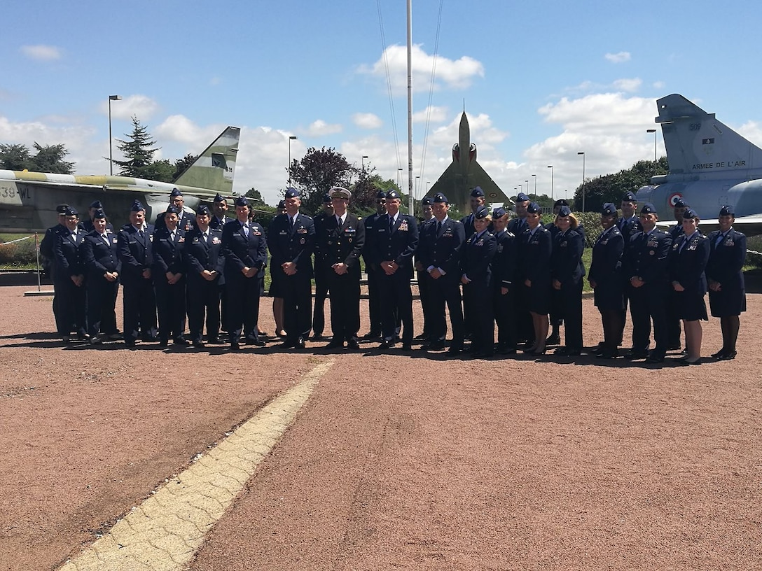 Participants from the U.S. Air Reserve Components pose for a photo with French Air Force Brig. Gen. Didier Tisseyre, Rochefort School Airbase commander, and U.S. Air Force Reserve Maj. Gen. James P. Scanlan, U.S. Head of Delegation, during the 23rd Annual International Junior Officer Development (IJOLD) course, held in Rochefort Air Base, France, July 22-29. IJOLD is designed to enhance and develop leadership skills, cultural understanding and military doctrine of NATO nations.