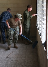 U.S. military service members clean and chip paint during a Southern Partnership Station 17 community relations project at a Honduran elementary school