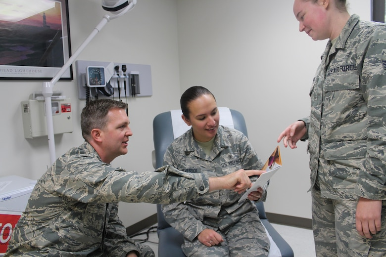 Maj. Justin Fox, 88th Medical Group plastic surgeon, and medical technician Senior Airman Leah Borland, discuss plastic surgery options with Airman 1st Class Brittany Hartsock (middle). The 88th Medical Group plastic surgery clinic's primary mission is to provide reconstructive procedures but also offers cosmetic procedures. (U.S. Air Force Photo/Stacey Geiger)