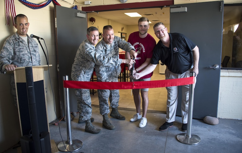 Brig. Gen. Brooke Leonard, 56th Fighter Wing commander, and Kevin Connauton, Arizona Coyotes hockey player, cut the ribbon with members of the Luke community at the Spiritual Maintenance Center on Luke Air Force Base, Ariz. Aug. 15, 2017. The Spiritual Maintenance Center was a place established for Airmen to become spiritually and physically strengthened through fellowship and mentorship from fellow Airmen. (U.S. Air Force photo/Airman 1st Class Alexander Cook)