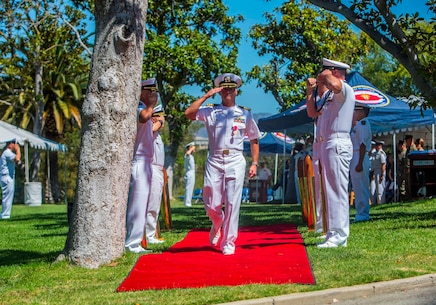"U.S. Navy Capt. Peter A. Ruocco returns a salute and departs from the 1st Dental Battalion change of charge ceremony at Camp Pendleton, Calif., Aug. 16, 2017. During Ruocco's departure, the sideboys render their honors as the boatswain ""pipes"" Ruocco ashore. The Boatswains pipe is traditionally used to pass commands to the crew as the sound of the crew or bad weather would drown out a Sailors voice. (U.S. Marine Corps photo by Lance Cpl. Joseph Sorci)"