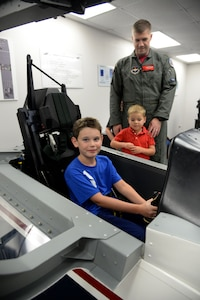 Airmen with the 559th Flying Training Squadron welcomed younger family members to Hangar 64 on Joint Base San Antonio-Randolph for Bring Your Child to Work Day August. 11.