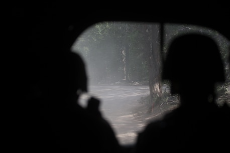U.S. Marines with Combat Logistics Battalion 5, Combat Logistics Regiment 1, 1st Marine Logistics Group, posts for security in the rear of the convoy during Mountain Training Exercise 4-17 at Mountain Warfare Training Center, August 6, 2017. Marines in the last vehicle of the convoy posts security in case of enemy contact to the rear. (U.S. Marine Corps photo by Lance Cpl. Timothy Shoemaker)