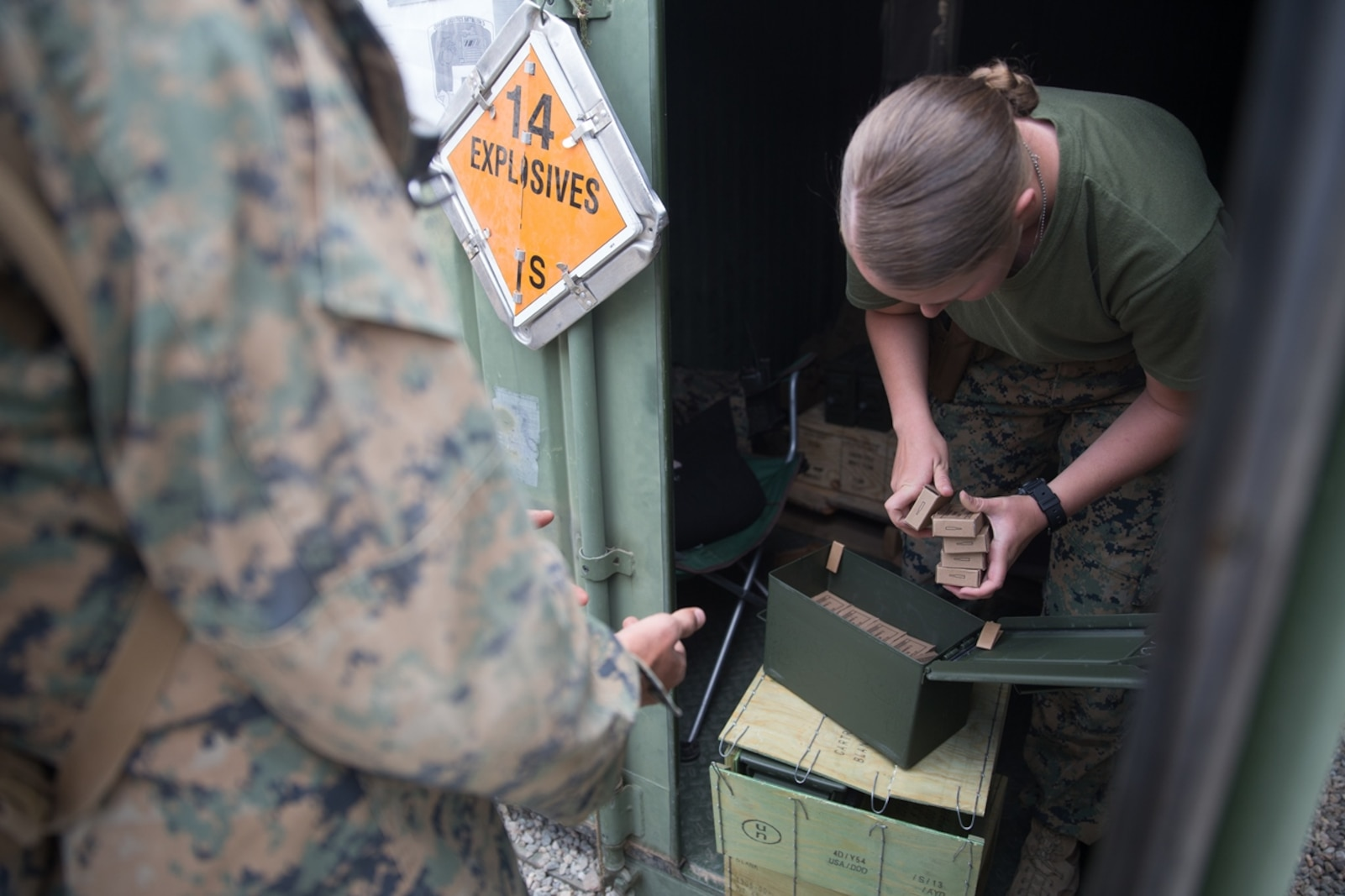 U.S. Marine Pfc. Olivia Rutherford, an ammo technician with Combat Logistics Battalion 5 (CLB-5), Combat Logistics Regiment 1, 1st Marine Logistics Group, counts out ammunition during Mountain Training Exercise 4-17 at Mountain Warfare Training Center, August 4, 2017. Blanks were handed to Marines to be used on the convoys in case of simulated enemy contacts. Throughout the training evolution, Marines with CLB-5 received over 9000 blank ammunition for the M16A4 service rifle for practical experience and utilizing their weapons. (U.S. Marine Corps photo by Lance Cpl. Timothy Shoemaker)
