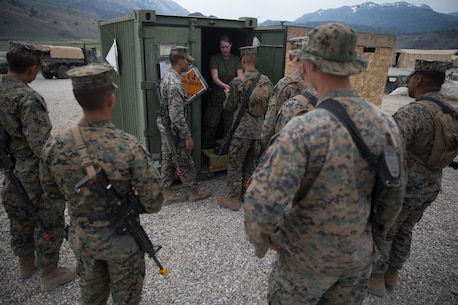 U.S. Marines with Motor Transportation, Combat Logistics Battalion 5, Combat Logistics Regiment 1, 1st Marine Logistics Group, receives blank ammunition during Mountain Training Exercise 4-17 at Mountain Warfare Training Center, August 4, 2017. Blanks were handed out to the Marines in case of simulated enemy contact while on a convoy. (U.S. Marine Corps photo by Lance Cpl. Timothy Shoemaker)