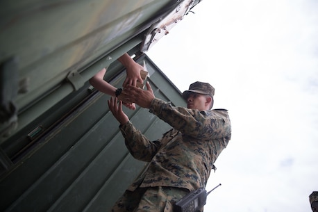 U.S. Marine Staff Sgt. Edgar Torres, a motor transportation chief with Combat Logistics Battalion 5, Combat Logistics Regiment 1, 1st Marine Logistics Group, receives blank ammunition during Mountain Training Exercise 4-17 at Mountain Warfare Training Center, August 4, 2017. Blanks were given to Marines to be used during the convoys in case of simulated enemy contact. (U.S. Marine Corps photo by Lance Cpl. Timothy Shoemaker)