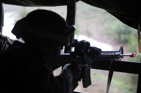 U.S. Marine Christopher Wilkerson, a motor transportation operator with Combat Logistics Battalion 5, Combat Logistics Regiment 1, 1st Marine Logistics Group, posts security while riding in a seven ton during Mountain Training Exercise 4-17 at Mountain Warfare Training Center, August 5, 2017. In case of a simulated enemy contact, Marines received blank ammunition to give real world experience in counteracting ambushes. (U.S. Marine Corps photo by Lance Cpl. Timothy Shoemaker)
