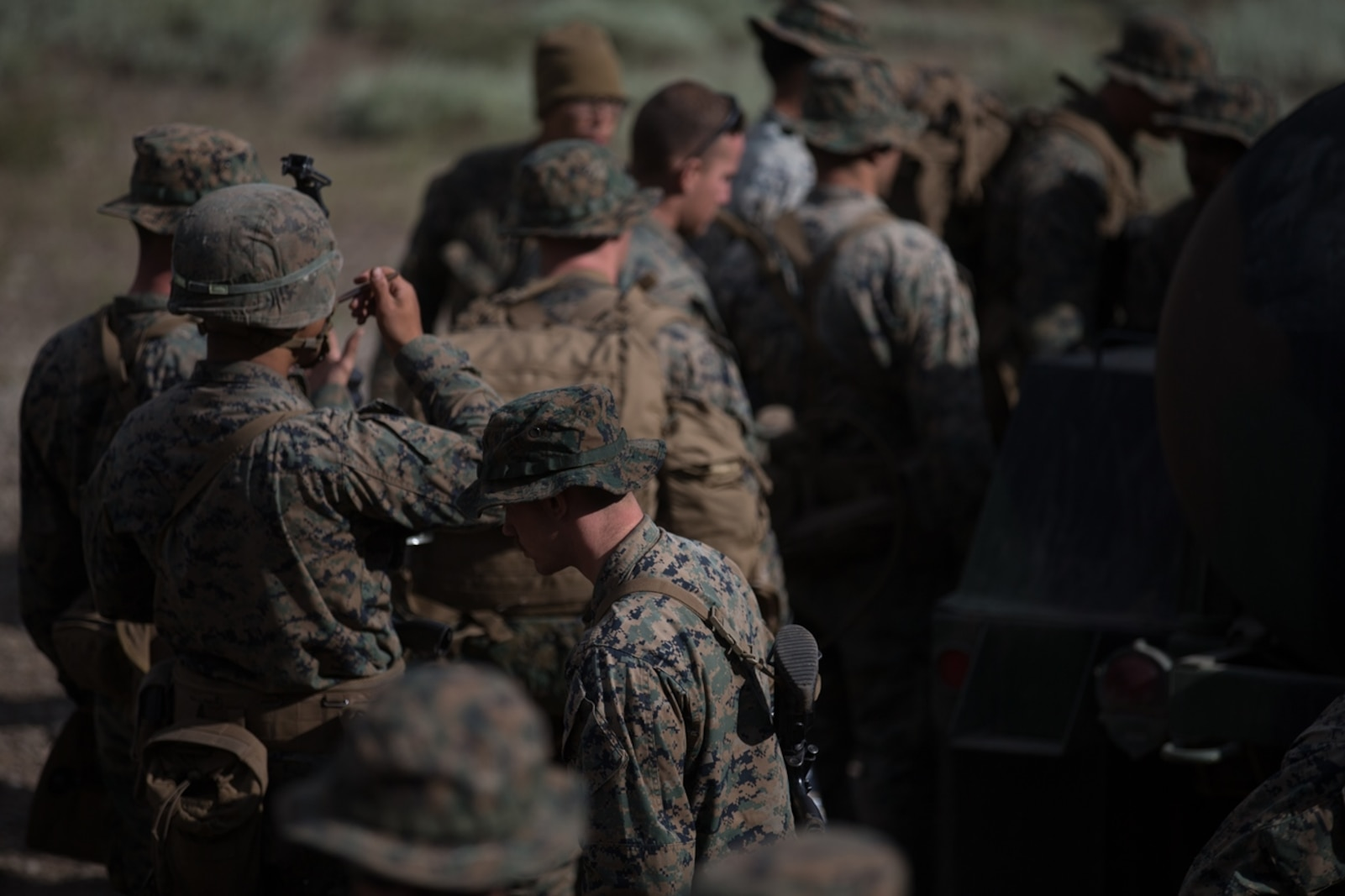 U.S. Marines with 2d Battalion, 8th Marine Regiment, 2d Marine Division receive water from the water trailer during Mountain Training Exercise 4-17 at Mountain Warfare Training Center, August 6, 2017. Marines with Combat Logistics Battalion 5, Combat Logistics Regiment 1, 1st Marine Logistics Group, support 2d Battalion, 8th Marines logistically by tackling the technical aspects of mountainous and cold weather operations by providing them chow, water, and fuel. The water trailer can hold up to 600 gallons of water and serves as the primary source of water to Marines in the field. (U.S. Marine Corps photo by Lance Cpl. Timothy Shoemaker)