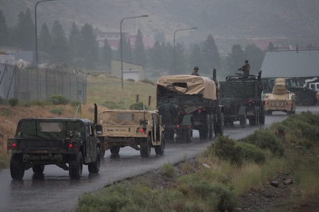U.S. Marines and Sailors with Combat Logistics Battalion 5, Combat Logistics Regiment 1, 1st Marine Logistics Group, participate in a convoy during Mountain Training Exercise 4-17 at Mountain Warfare Training Center, August 5, 2017. Convoys were needed to deliver chow and water to Marines with 2d Battalion, 8th Marine Regiment, 2d Marine Division. (U.S. Marine Corps photo by Lance Cpl. Timothy Shoemaker)