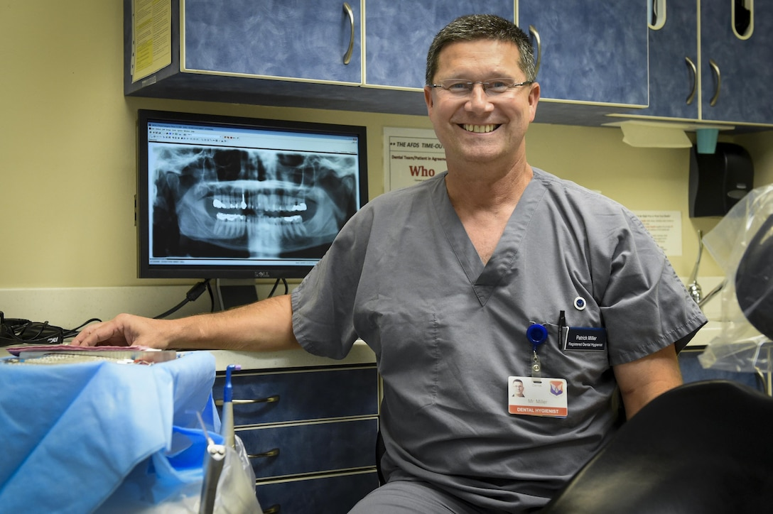 Patrick Miller, 628th Medical Group chief of preventative dentistry, dental hygienist, sits in an exam room at the Deily Dental Clinic on Joint Base Charleston, South Carolina, Aug. 1.