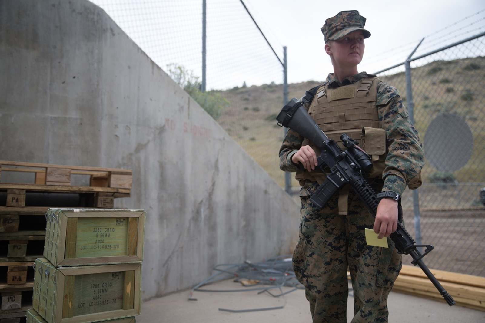 U.S. Marine Pfc. Olivia Rutherford, an ammunition technician with Combat Logistics Battalion 5, Combat Logistics Regiment 1, 1st Marine Logistics Group, receives blank ammunition during a field operation while participating in Mountain Training Exercise 4-17 at Marine Corps Mountain Warfare Training Center, August 3, 2017. Blank ammunition are rounds without projectiles and are used for training purposes only. (U.S. Marine Corps photo by Lance Cpl. Timothy Shoemaker)