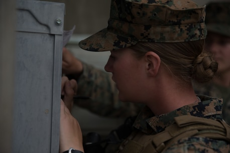 U.S. Marine Pfc. Olivia Rutherford, an ammunition technician with Combat Logistics Battalion 5, Combat Logistics Regiment 1, 1st Marine Logistics Group, signs documentation indicating she received blank ammunition that will be distributed to the Marines participating in Mountain Training Exercise 4-17 at Marine Corps Mountain Warfare Training Center, August 3, 2017. An ammo technician works in every aspect of the ammunition field, including receipt, storage, issue, and handling of ammunition and toxic chemicals. (U.S. Marine Corps photo by Lance Cpl. Timothy Shoemaker)