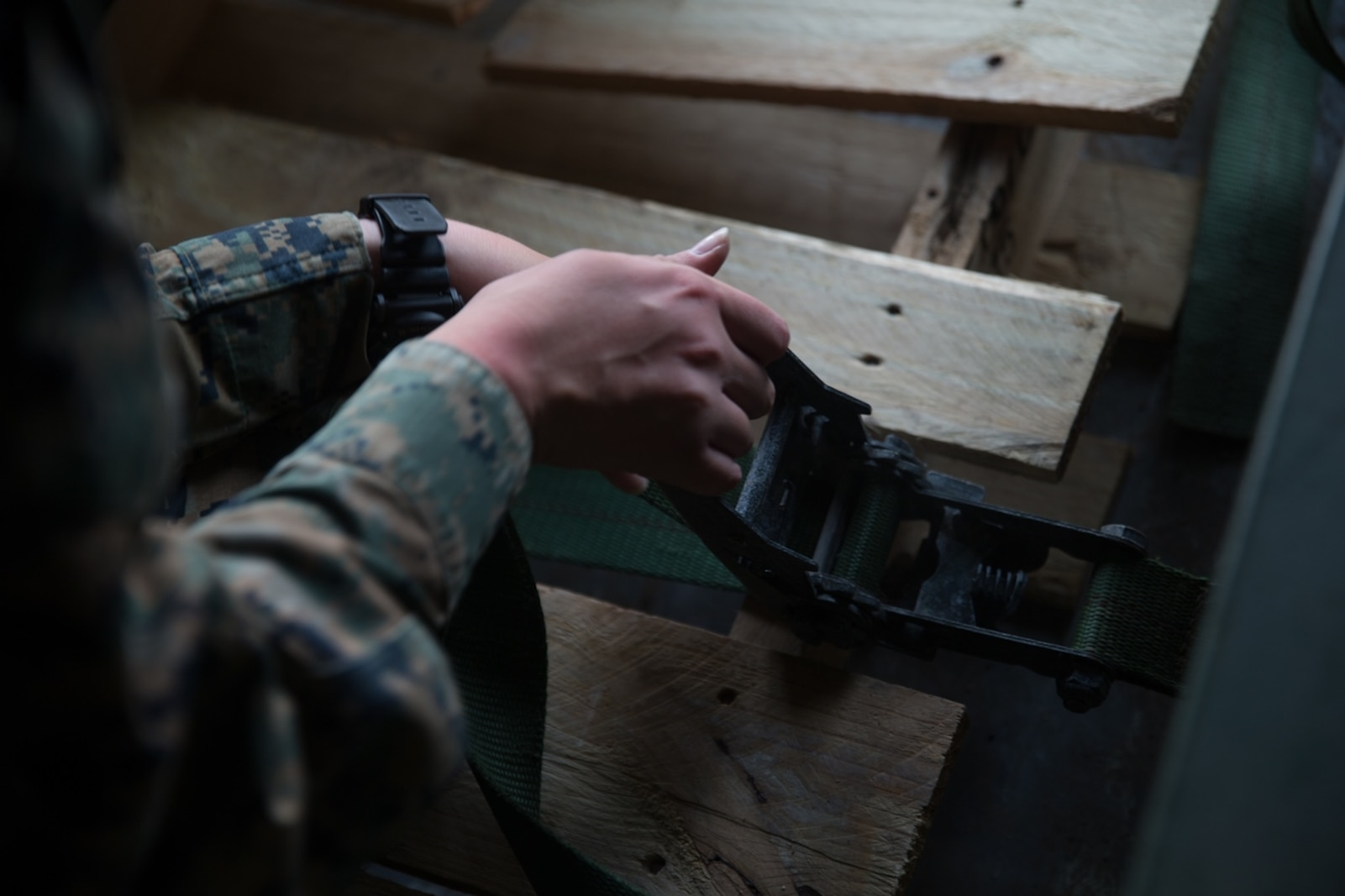 U.S. Marine Pfc. Olivia Rutherford, an ammunition technician with Combat Logistics Battalion 5, Combat Logistics Regiment 1, 1st Marine Logistics Group, uses a strap to tie down ammunition during Mountain Training Exercise 4-17 at Marine Corps Mountain Warfare Training Center, August 3, 2017. An ammo technician works in every aspect of the ammunition field, including receipt, storage, issue, and handling of ammunition and toxic chemicals. (U.S. Marine Corps photo by Lance Cpl. Timothy Shoemaker)